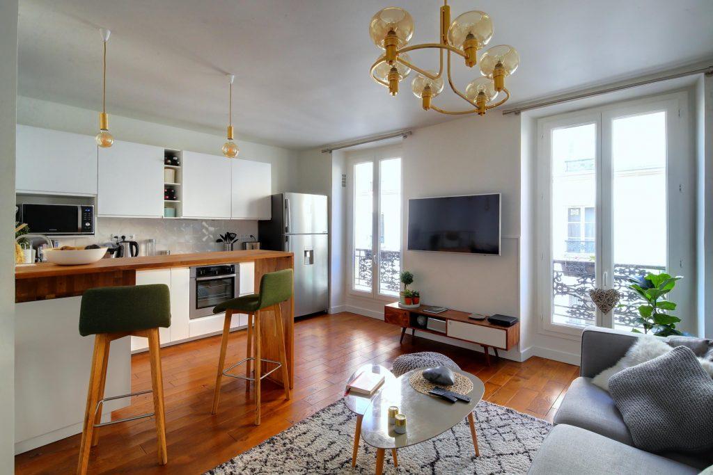 rénovation amenagement d'une cuisine ouverte sur salon style nordique appartement parisien